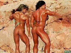 2 well bodied form women posing together