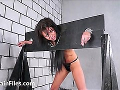 Wooden stocks whipping of lesbian brazilian bdsm babe in hardcore spanking