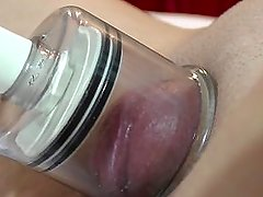 Big clit close-up pussy pump