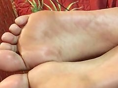 Short clip of exotic mixed girl soles whipping