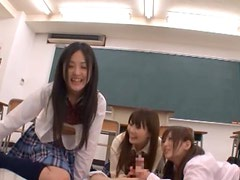 Horny Japanese Students Play With A Hard Cock In Class