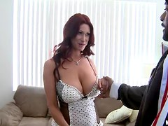 Busty Redhead shows her Fiery Moves