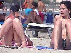 Sexy topless girls filmed on public beach by voyeur