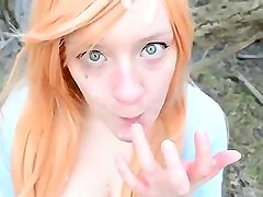 red head Petite girl givong a blow job
