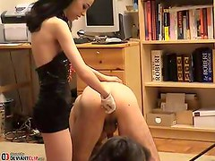 Twisted crazy girl deeply fists her submissive slave!