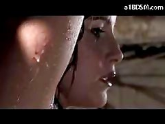 Busty Girl With Tied Arms Whipped While Water Falling To Her In The Basement