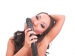 Asa Akira toys her holes with a double dildo
