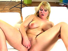 Chubby chick and her toy have fun