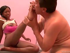 Hot ebony teen getting her feet licked on by horny man