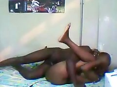 Horny black couple gets it on