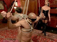 Sexy Blonde Mistress has her way with two tied guys
