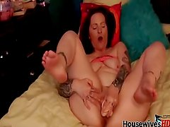 Canadian amateur tattooed cougar playing with toy
