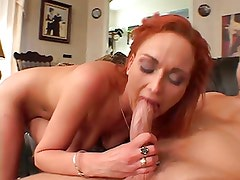 Red-headed whore gored by white cock in the living room