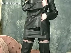 Busty blonde babe upskirt in nylons leather thigh boots and opens up blouse