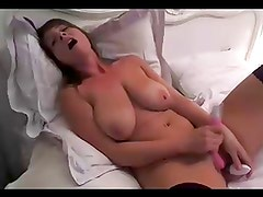 Hottie with giant tits plays with dildos on webcam