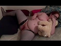 Sexy teen redhead in fishnet stockings masturbates and cums for her daddy