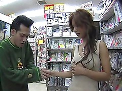 Akane Hotaru sucks a strangers cock at the adult video store