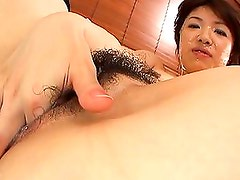 Mitsu Anno pretty Asian gal in fishnets gets hairy pussy fucked