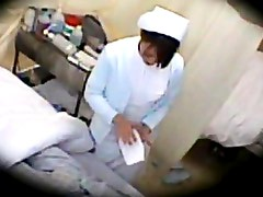 Amateur in a nurse uniform and stripping her male patient