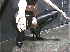 Hot chick in mask and rubber gets tortured