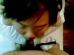 Young Chinese Wife Sucking Cock