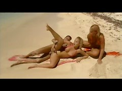 Gorgeous blonde duo anal fucked at the beach