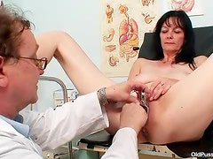 Pretty mature babe fingered by her doctor