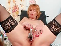 Sexy mature chick in stockings gets an exam