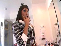 Milf in slutty outfit sucks on a black cock