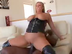 Busty blonde cougar in corset fucks black cock