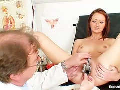 Teenage redhead with speculum in her pussy
