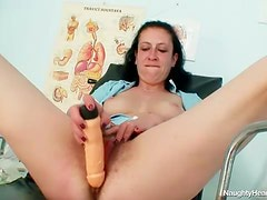 Hairy mature pussy banged by a toy