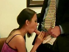 Asian in a dress sucks his cock in office