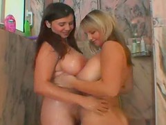 Two huge titty lesbians make out in shower
