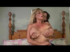 Curvy milf scissoring with a young lady