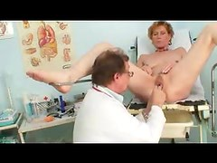 Nude girl visits the gyno for an exam