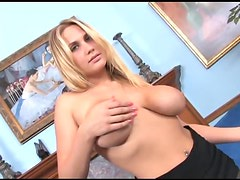 Busty blonde MILF teases in sheer black pantyhose