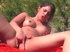 Finger banging girl outdoors with hard nipples