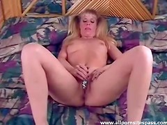 Amateur blonde with pigtails slides dildo in her moist snatch