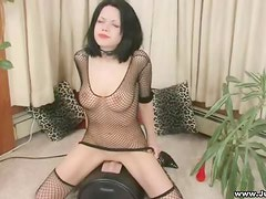 Fair skinned goddess with jet black hair riding sybian