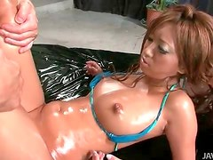 Oriental honey with nice ass gets oiled and sprayed