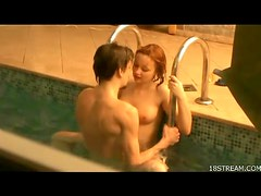 Young couple kissing and fucking in pool