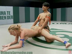 Asian Babes Fucks A Blonde With A Strapon On The Ring