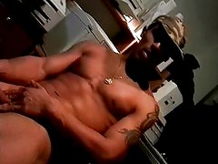 Ripped stud jerks off his black cock