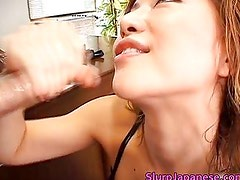 Super hot asian babe slurping cum off