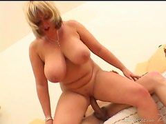 Busty Mature Blonde Titty Fucks A Hard Boner