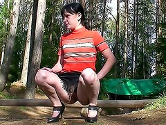 Gorgeous Milana with shaved pussy likes to pee on the nature