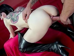 Tattooed leather girl banged in kinky video