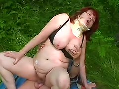 Good looking Ivana is satisfying her old daddy outdoors