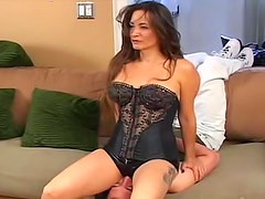 Chick in latex shorts sits on his face